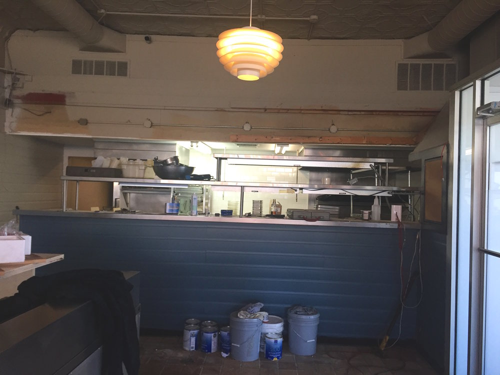 Open kitchen, in progress, at Harbinger.