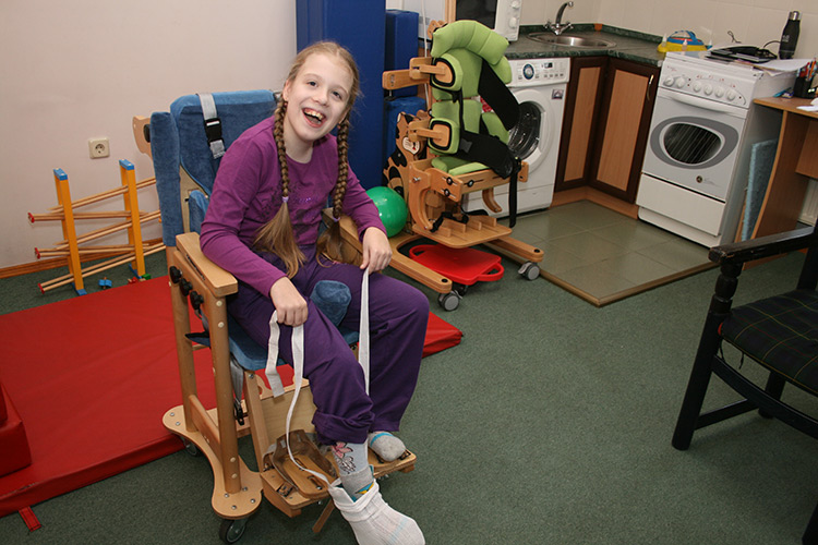 Nastya can now put on her socks with the help of an assistive device