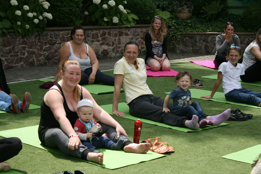 Nastya and her baby boy at worship yoga (first left to right)