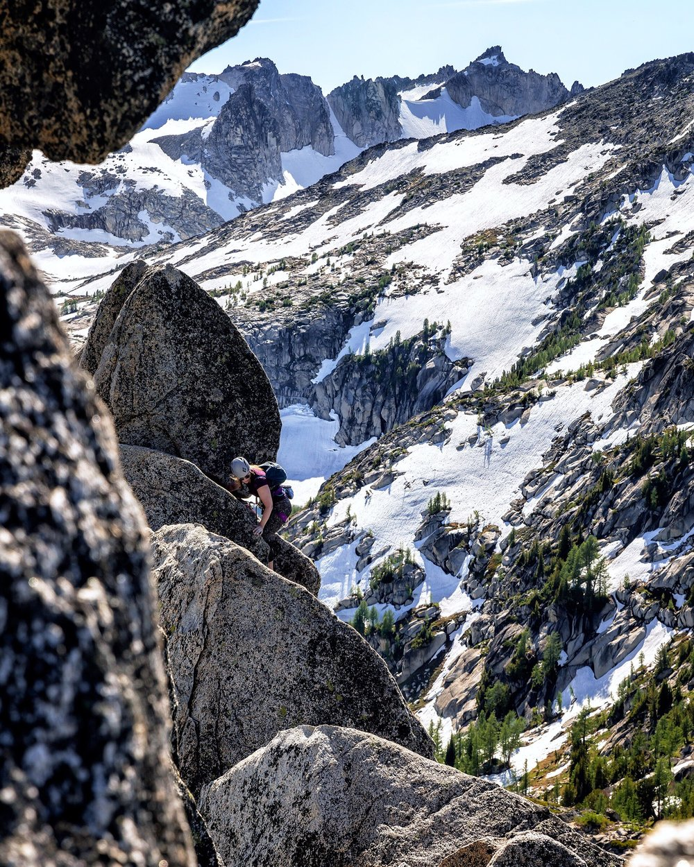 That's me, asking the age old question while leading up the West Ridge of Prusik Peak: if you place pro while wearing leggings, do you even climb? Photo courtesy of  Nick Lake.