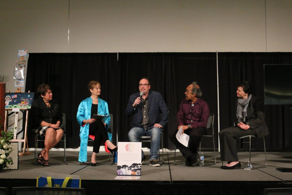 Gordon K. Squires, Caltech/IPAC astronome (Center), talking about Pasadena's rich history of Astronomy at the Live On Green STEAM 2018 Panel Discussion after the declaration presented to Pasadena STEAM by Mayor Tornek. Also in this image from L to R: Dianne Philibosian, Board Member, PCOC, Joan Aarestad, STEAM18 Project Manager, Nick Smith, with the Pasadena City Library, and Katie Brandon with the Pasadena Museum of History