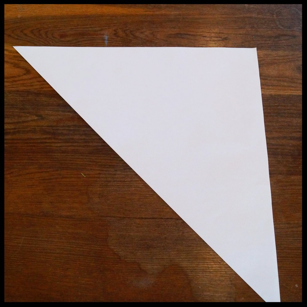 1a. Take a piece of paper and fold it in half, corner to corner. Unfold and repeat with the other corners. You will end up with 2 diagonal creases.