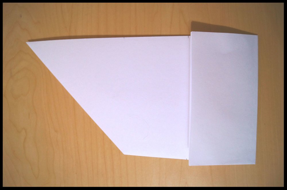 4.       Fold the right side (the rectangular part) in one-third of the way. Repeat so the entire rectangle portion of the paper is folded.