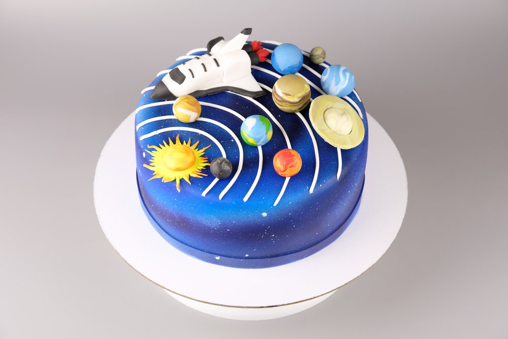 bigstock-Cake-With-The-Image-Of-The-Cos-252165055.jpg