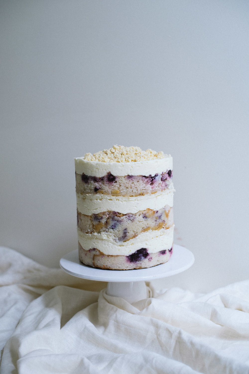 Blueberry Lemon Layer Cake  // Blueberry Cake, Lemon Buttercream, Cheesecake, White Chocolate Milk Crumb