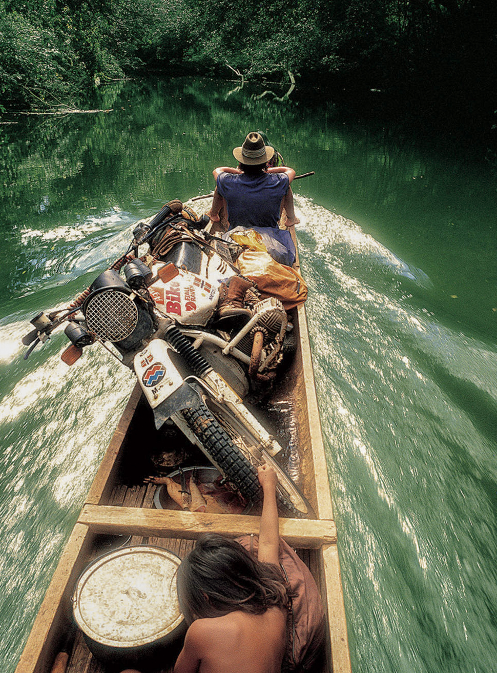 Helge g oing upriver on the Amazonas on a small motorized canoe, tipping is not an option.   (  ©Helge Pedersen)