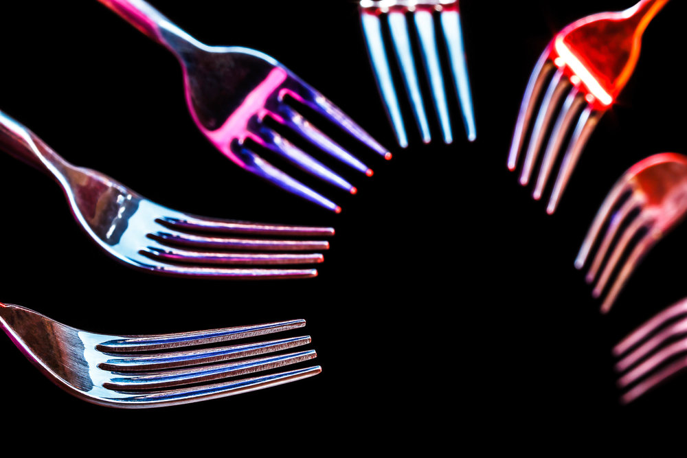 forks-in-circlular-pattern-under-colored-lights-0098_31DEC10.jpg