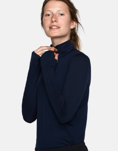 Outdoor Voices  is a great brand to look at! Their looks are modern and chic. This merino wool top also looks great with jeans and a vest, for those days you can go a bit more casual.