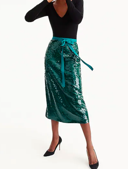 J Crew: Sequin Midi Skirt   Nothing says holiday outfit better than sequins!! While this may be too bold on its own, you can pair it with a camel jacket and a wool scarf to soften the shine of the skirt.