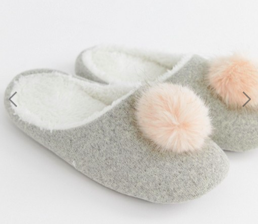 ASOS: Pom Slipper  How fun are these?! These cozy and cute slippers are sure to remind your loved one to have a little fun and pep! Everybody needs a comfy slipper and why not go for something with a little more zest!