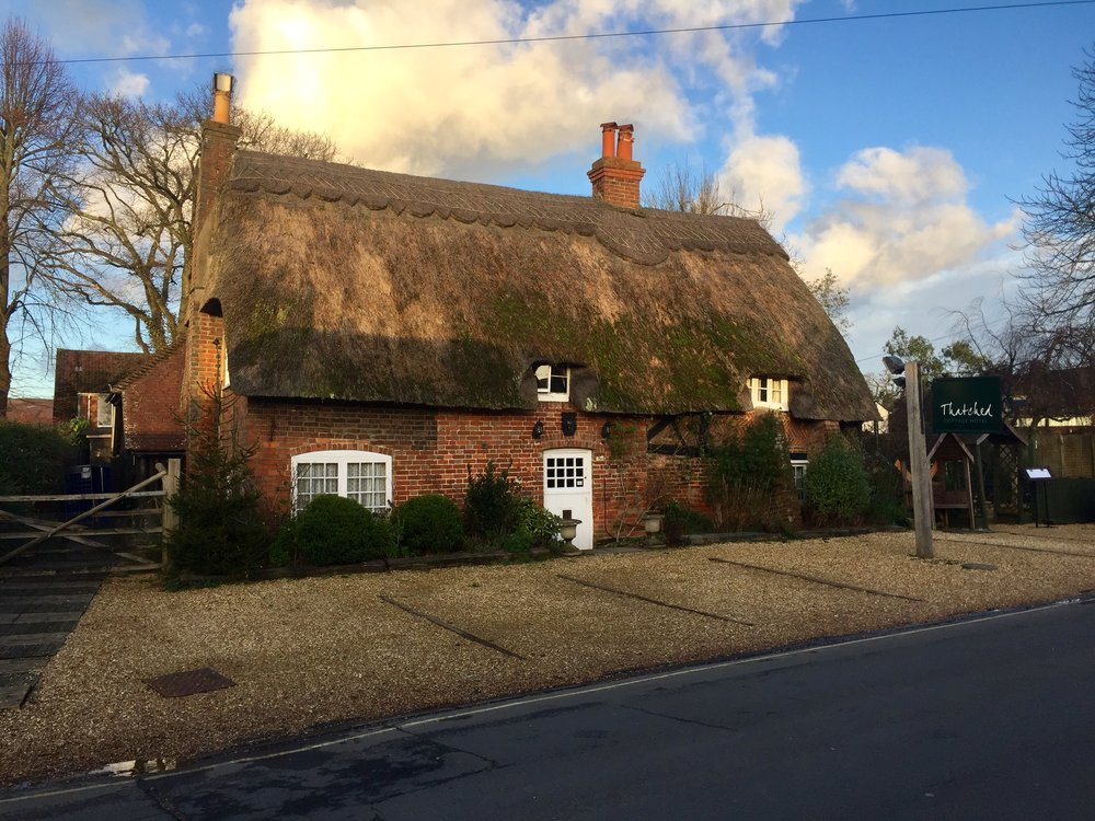 Our home in February, built in 1627,   The Thatched Cottage