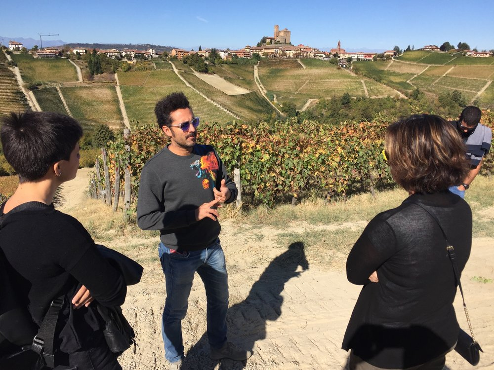 Enrico sharing his passion for wine with us and Serralunga in the background