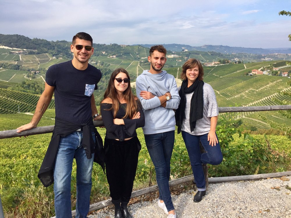 Nieko, Idan, Jonah, and Betsy with the Serralunga hills covered in vines