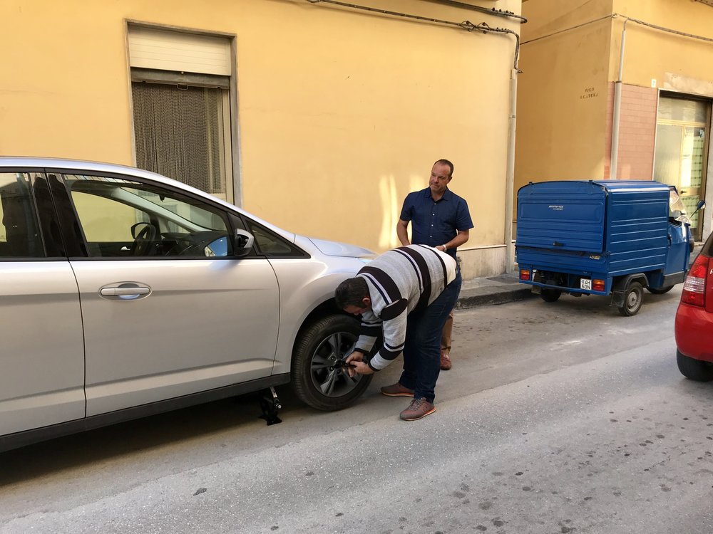 "Massimo ""helping"" Greg change a flat in Noto, Sicily"