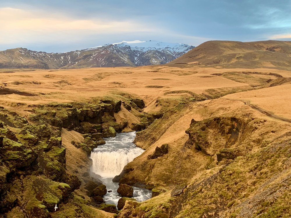 Skogafoss gorge with Eyjafjallajökull glacier in the background