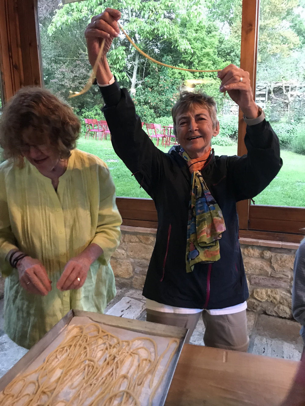 One of our small group tour participants making another classic Tuscan dish, pici pasta!