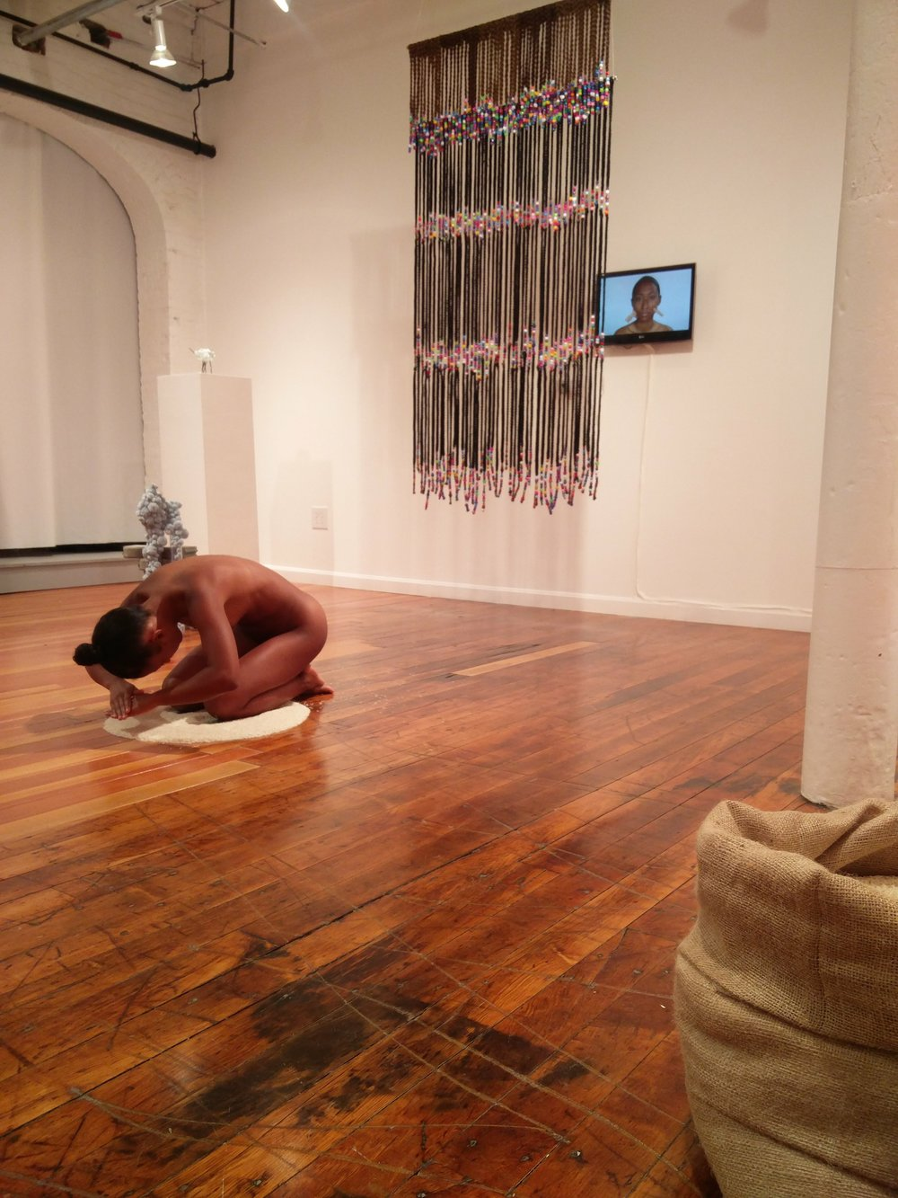 Dana Davenport,   Box Braid Curtain , 2016, synthetic kabkalon hair, beads;  Learning Korean, 2015,  video;  One Hundred Fifty Thousand Won , 2017, rice and Korean won. (installation and performance)