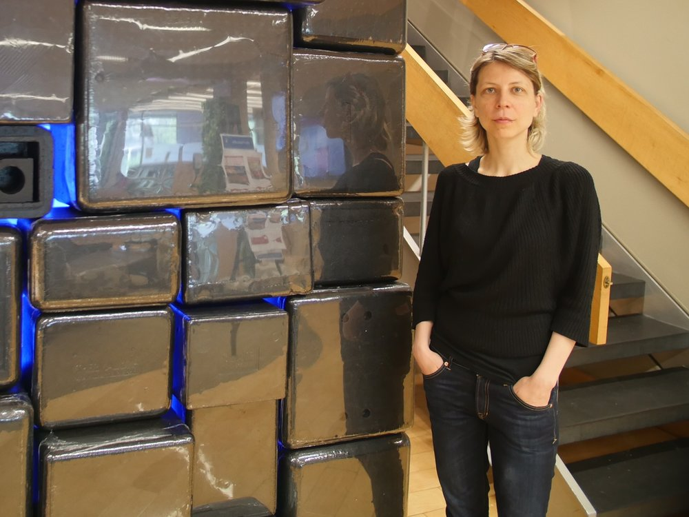 Sylvia in front of her sound installation at HGSE's Gutman Library