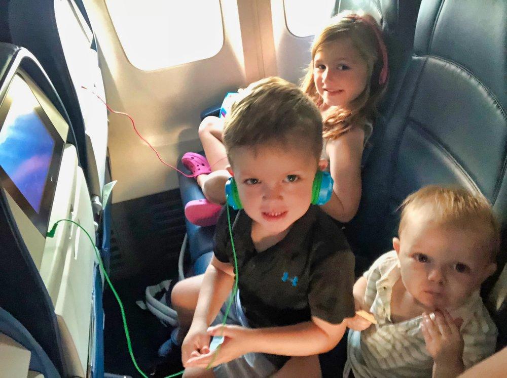 3 kids on a plane.jpeg
