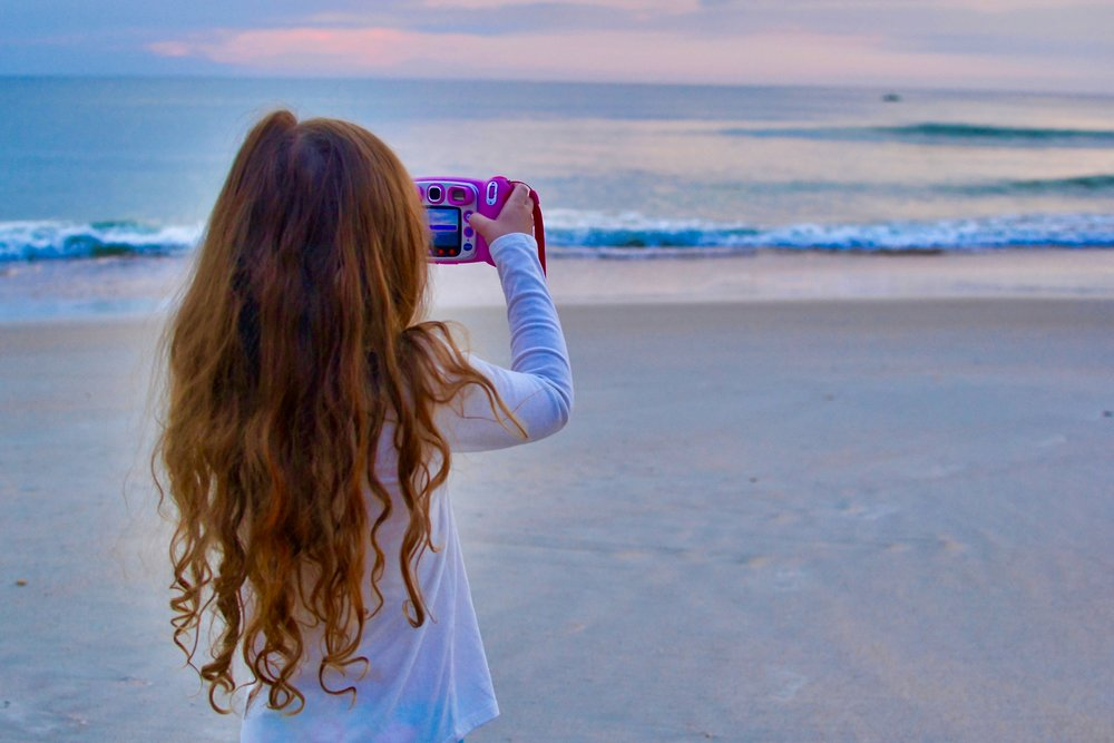 Pippa taking photos at the beach.jpeg