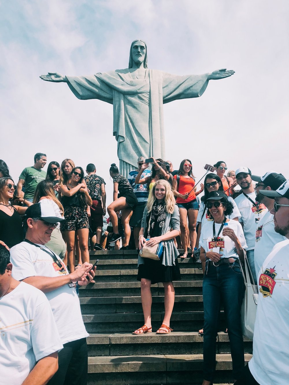 posing in front of Christ the Redeemer