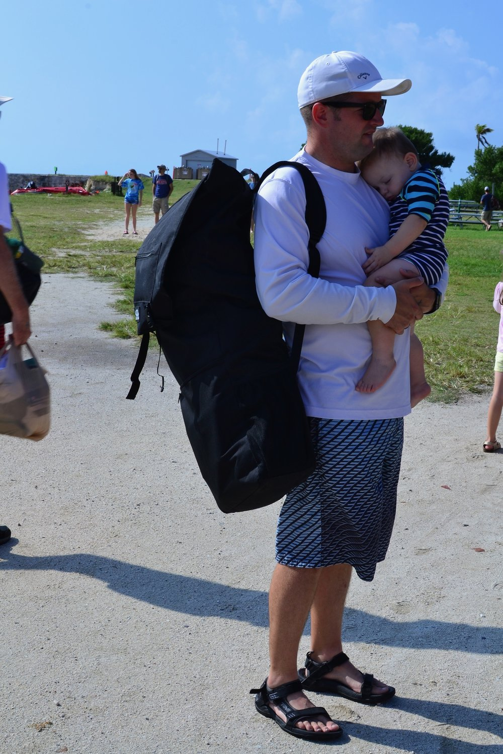 My husband, the hero, holding all of our gear for the Dry Tortugas and holding a sleeping baby.