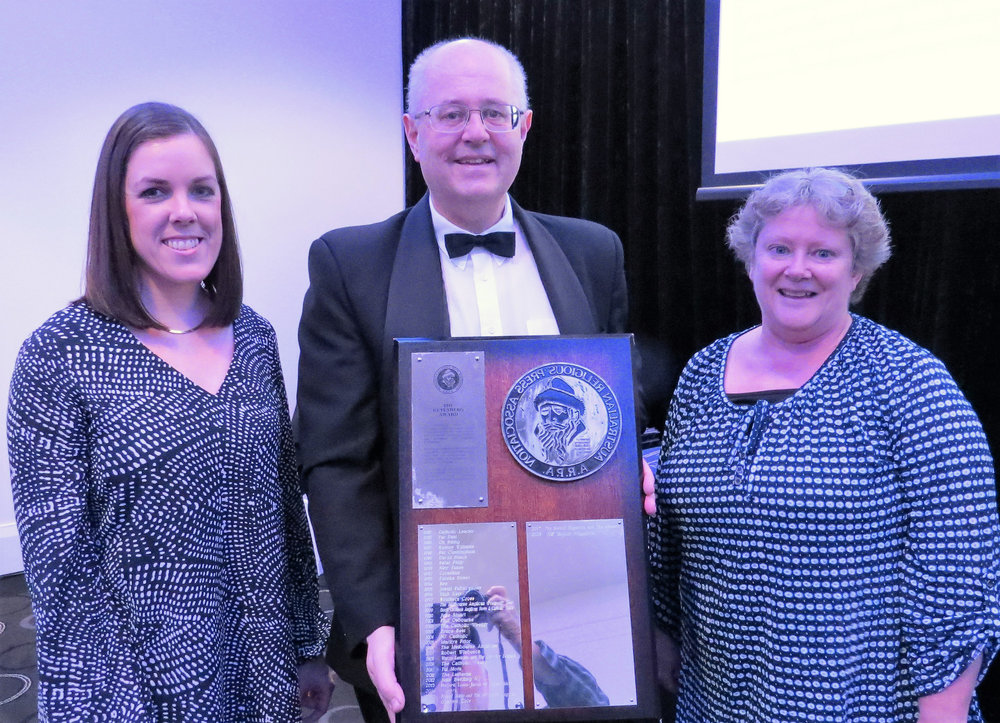 Graphic Designer Rebecca McLeay and Editor Linda Grigg accept the 2018 Gutenberg Award from ARPA President Peter Bentley on behalf of the magazine NZ Baptist.