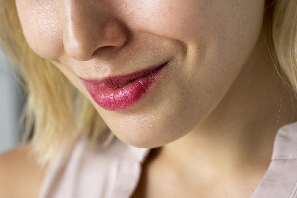 closeup-of-smiling-woman-39-s-smile-PF86BLU.jpg