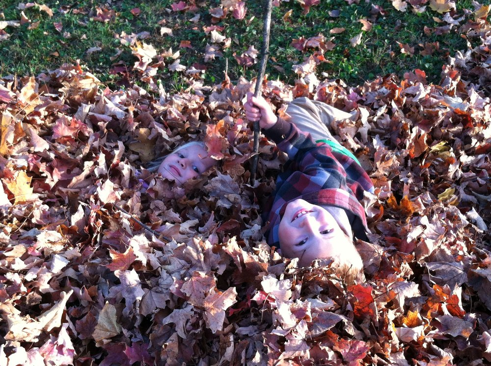 My kids CELEBRATING in the leaves 4 years ago!