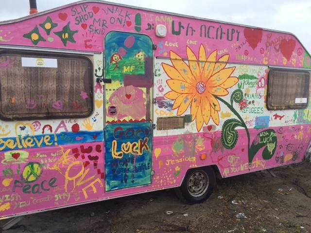 Pink caravan at a refugee camp