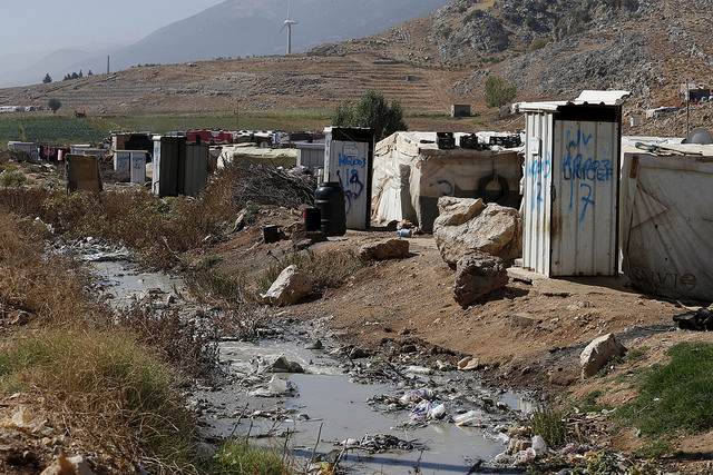 Toilets donated by Unicef and World Vision stand near tents at a Syrian refugee settlement camp in Qab Elias in the Bekaa Valley, near Baalbek, Lebanon October 17, 2015. REUTERS/Jamal Saidi
