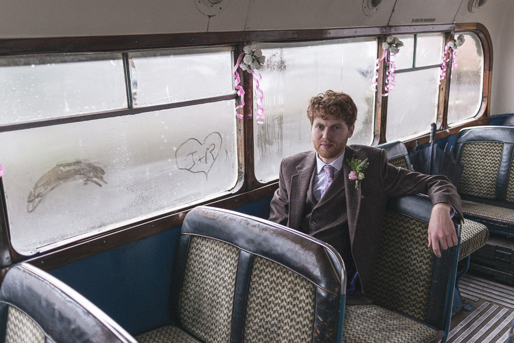 Groom sits in wedding bus waiting for service to begin in Croston