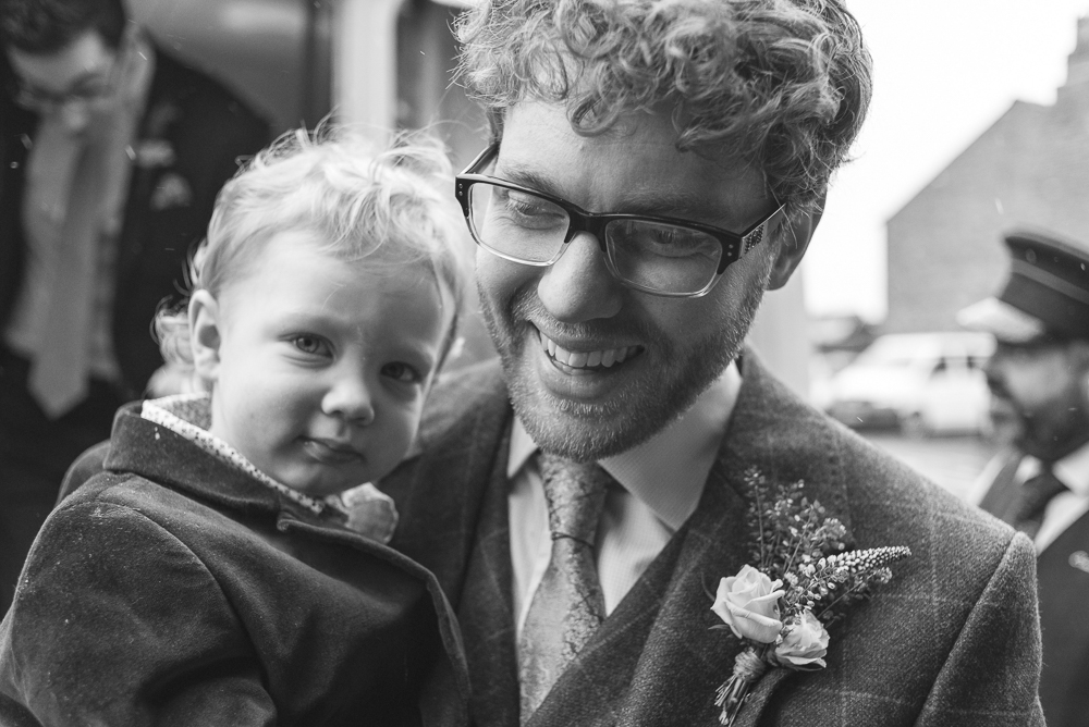 Groom and son on a rainy wedding day in Croston