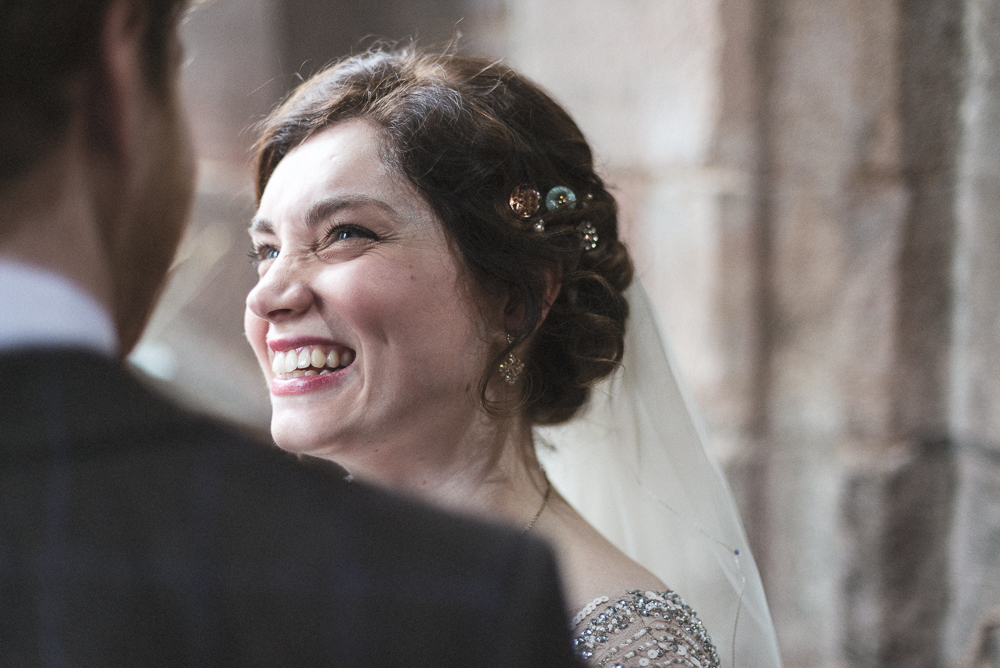 Bride laughs in the church of St Michael's in Croston Lancashire