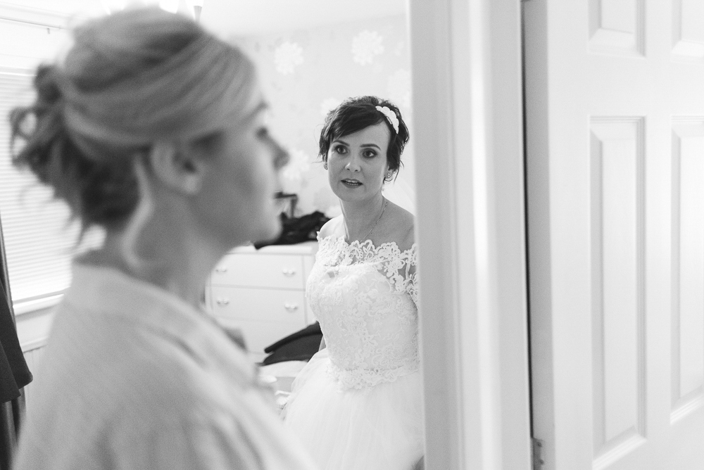 Bride looking at bridesmaid in Salford
