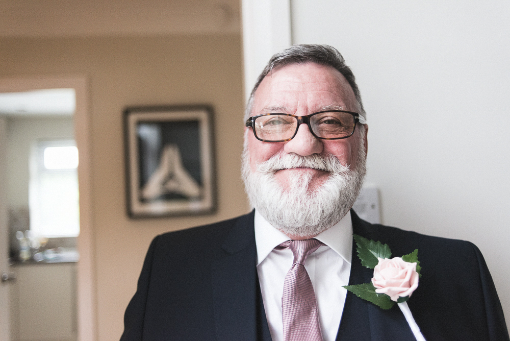 Father of the bride looking happy on his daughter's wedding day