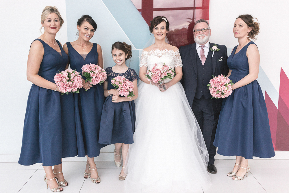 Bridal party pose for a photo in Salford's Media City