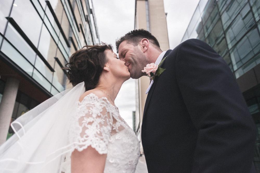 Bride and groom kiss, Salford wedding photographer