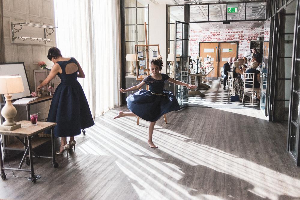 Girl dances ballet during a media city wedding. Wedding photography salford