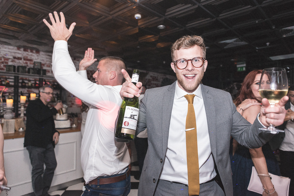 Man dances during wedding. Wedding photography Salford