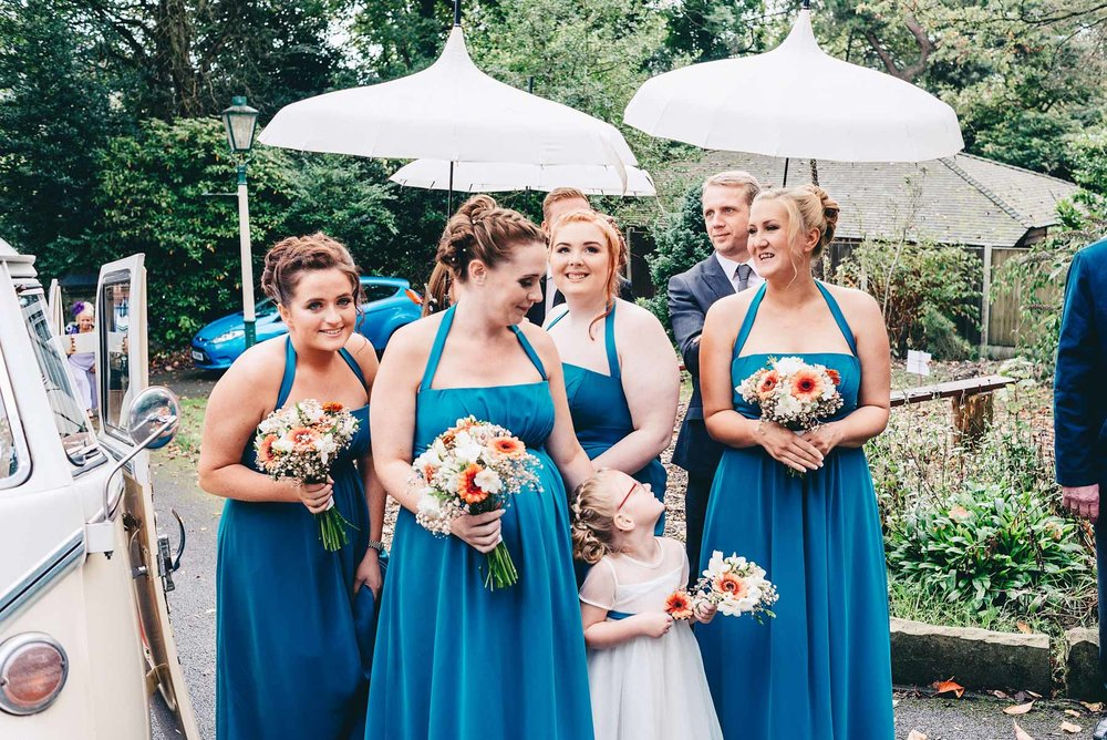 Bridesmaids talk outside church