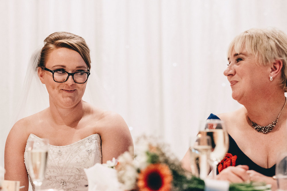 Bride looks at mum during wedding speeches