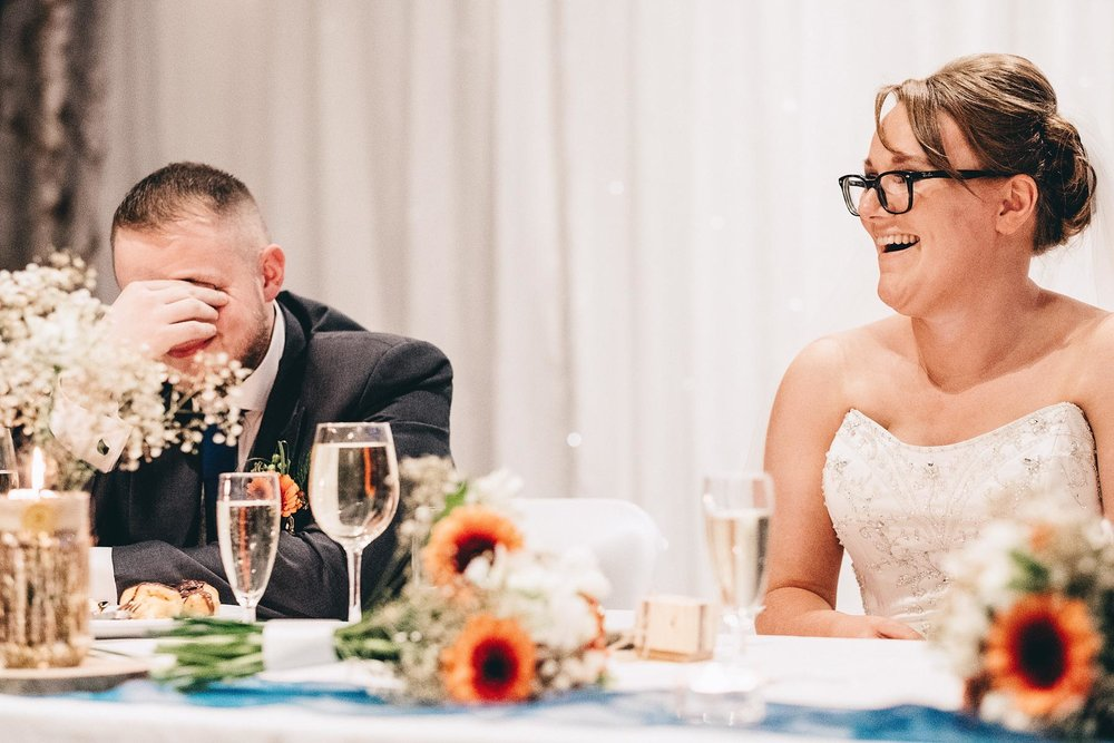 Groom holds his head during speeches