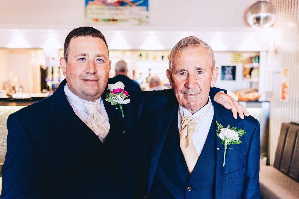 Father and son on sons wedding day