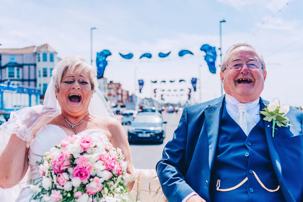 Bride and her father laugh while riding through Blackpool