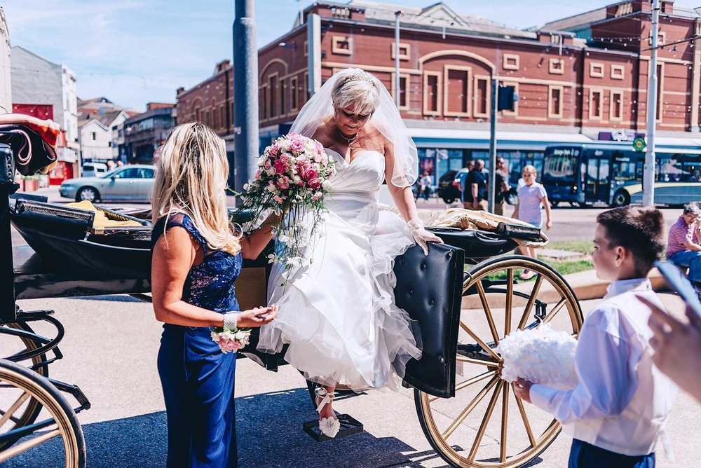 Bride steps down from her horse and cart