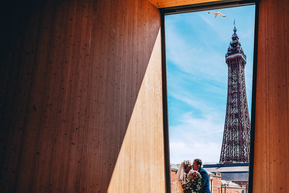 Bride and Groom kiss in front of Blackpool Tower