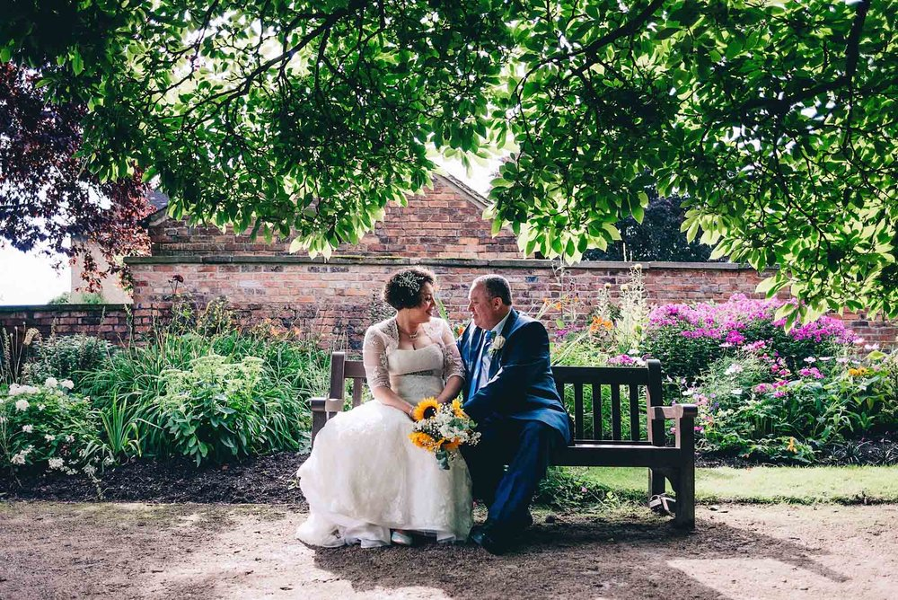 Bride and groom in Didsbury Parsonage gardens