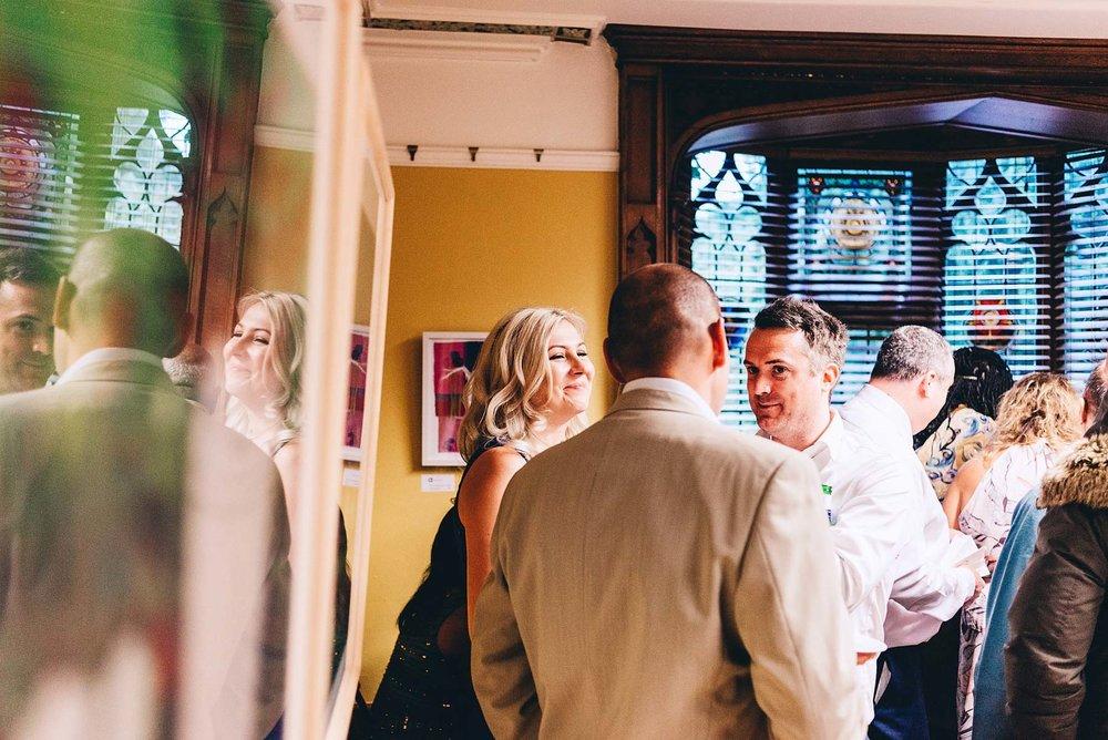 Guests talk at wedding reception
