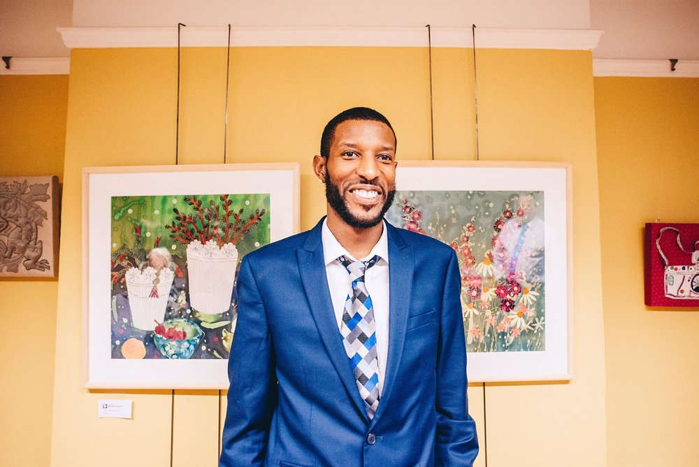 Wedding guest smiles and poses for portrait
